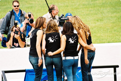 The girl group Soluna signing the Canadian and US national anthems before the race