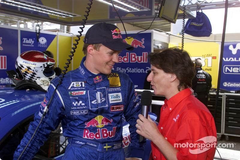 Mattias Ekström being interviewed by ex-DTM driver Ellen Lohr