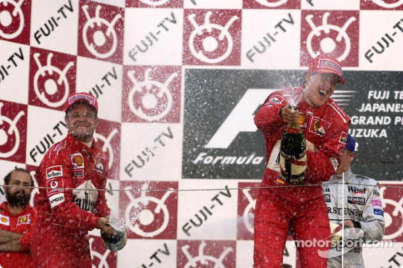 The podium: champagne for Michael Schumacher and Rubens Barrichello