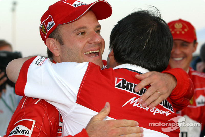 Rubens Barrichello celebrates with a Bridgestone team member