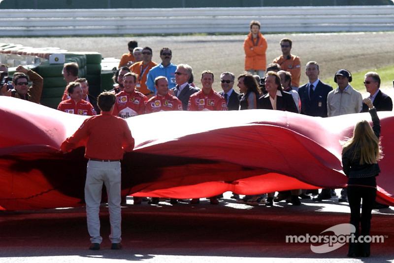 Jean Todt, Luciano Burti, Rubens Barrichello and Michael Schumacher