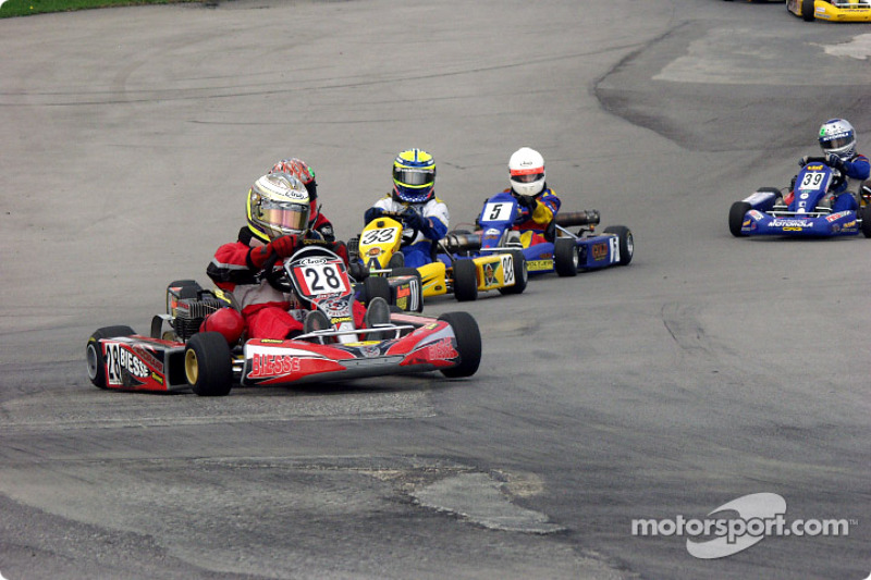 #22-Jason Fredericks, of Middletown, NY, leads #6-Trevor Daley in 125cc Shifter
