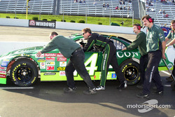 Mike Wallace helping to push the car