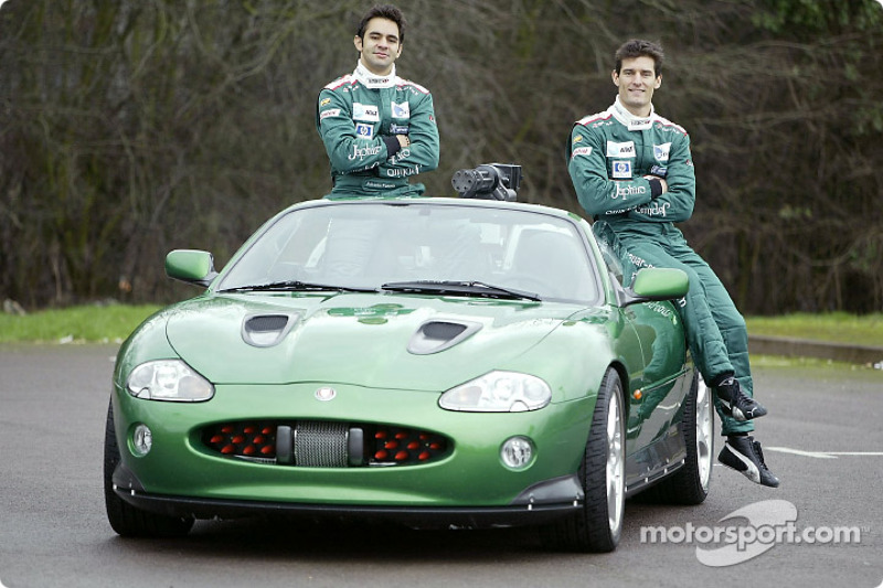 Mark Webber and Antonio Pizzonia pose with the James Bond 007 XK-R during a photoshoot at the Jaguar
