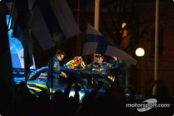 The podium: Tommi Makinen and Kai Lindstrom celebrate second place