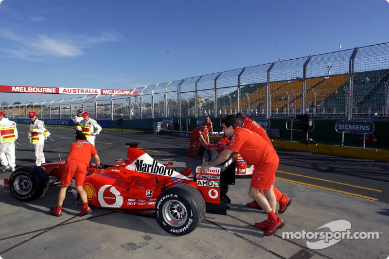 Ferrari team members head to technical inspection