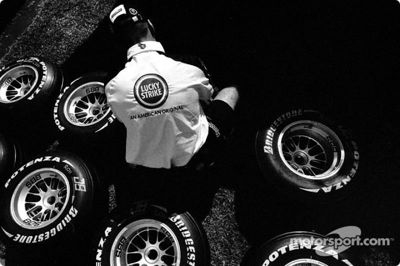 BAR crew member prepares tires
