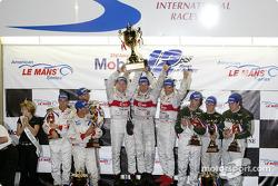 The podium: race winners Frank Biela, Marco Werner and Phillip Peter celebrate with Stefan Johansson, Emanuele Pirro, J.J. Lehto and Johnny Herbert, David Brabham, Mark Blundell