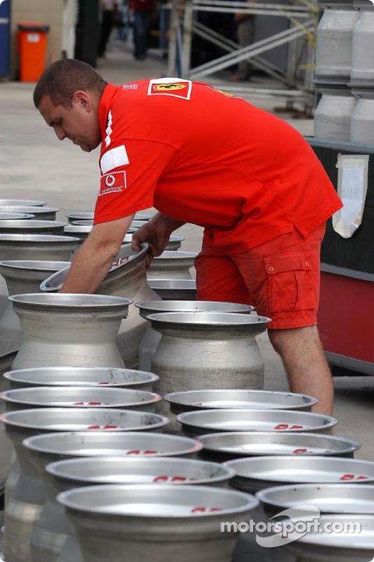 Ferrari team member prepares the wheels