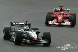 David Coulthard leads Michael Schumacher