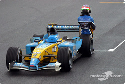 Jarno Trulli keeps his car from going down