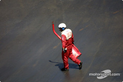 NASCAR official with a gas can