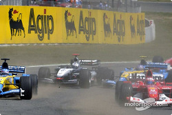 First corner: trouble at the back between David Coulthard and Jarno Trulli