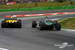 Mark Webber passes Ralph Firman