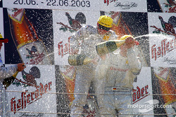 The podium: champagne for race winner Christijan Albers and Bernd Schneider