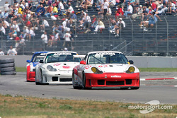 David Murry in the #83 Rennwerks Porsche GT3 RS leads cars through the infield section of California Speedway