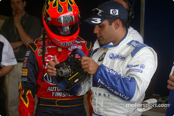 Jeff Gordon, left, listens closely as Juan Pablo Montoya explains the many buttons and switches on an F1 steering wheel