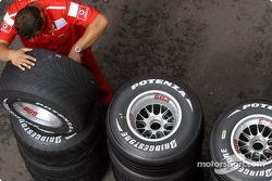 Ferrari team member works on wheels