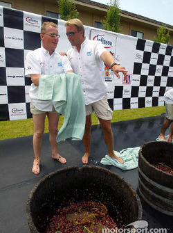As they clean up after the grape stomp contest, ADT Champion Racing teammates Johnny Herbert and J.J. Lehto compare notes; Herbert won the contest