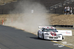 Robert Dopp drops two wheels in the dirt exiting T8a