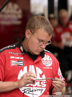 A member of Doug Kalitta's crew cleans a part