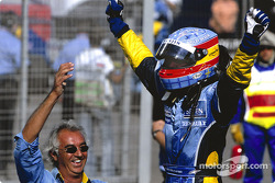 Race winner Fernando Alonso celebrates