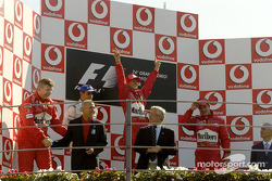 Podium: race winner Michael Schumacher with Juan Pablo Montoya and Rubens Barrichello