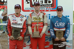 O'Reilly Tulsa 100 winner Bud Kaeding is flanked by runner-up J.J. Yeley (left) and Tyler Walker (right) after winning Sunday's USAC Weld Racing Silver Crown event