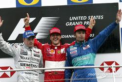 Podium: race winner Michael Schumacher with Kimi Raikkonen and Heinz-Harald Frentzen