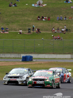 Craig Lowndes tries a pass on John Bowe