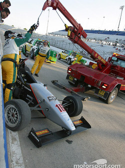 Stephan C. Roy's wrecked car against the pitwall