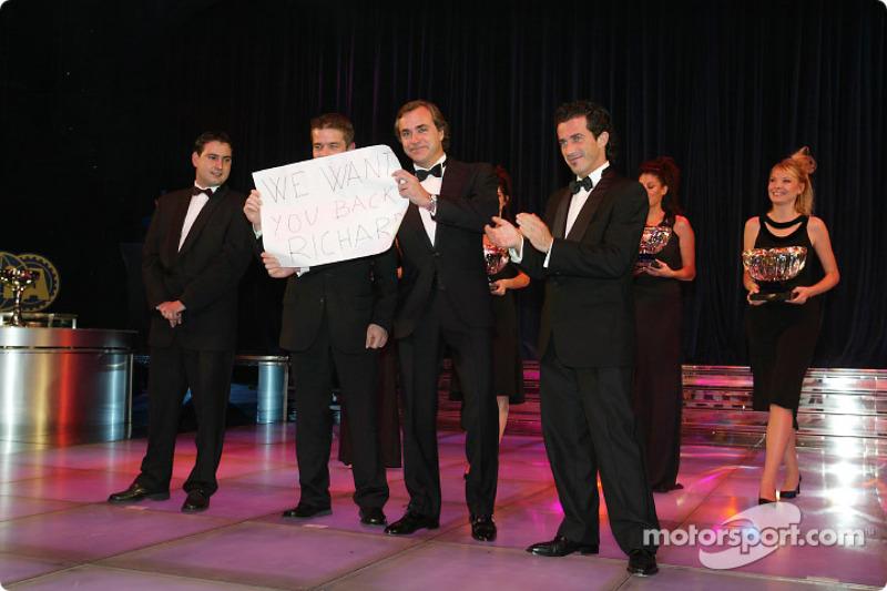 Carlos Sainz, Sébastien Loeb, Marc Martin and Daniel Elena holding a Miss you Richard Burns sign