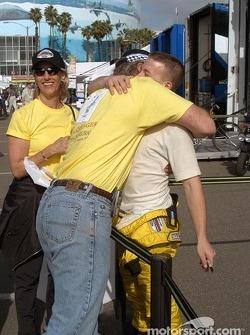 Fans greet A.J. Allmendinger with a commemorative ChampCar start T-shirt