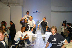 Models wearing PUMA for BMW WilliamsF1 Team Collection ve Ralf Schumacher sitting, Ice-Car