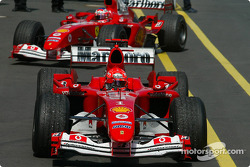 Race winner Michael Schumacher arrives in Parc Fermé