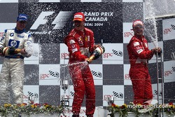Podium: champagnefor race winner Michael Schumacher, Ralf Schumacher and Rubens Barrichello