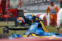 Fernando Alonso checks his car