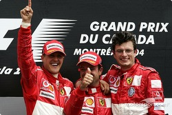 Podium: race winner Michael Schumacher with Rubens Barrichello