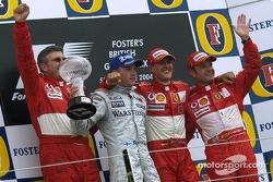 Podium: race winner Michael Schumacher with Kimi Raikkonen, Rubens Barrichello and Ross Brawn