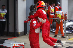 Race winner Michael Schumacher celebrates victory with Ross Brawn