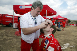 Marcus Gronholm and Marlboro Peugeot Total team doctor Patrice Guillemautot