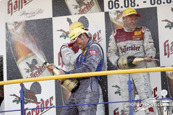 Podium: champagne for Tom Kristensen, Martin Tomczyk and Manuel Reuter
