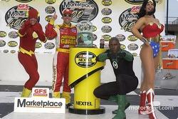 Victory lane: race winner Greg Biffle celebrates with The Flash, Green Lantern and Wonder Woman