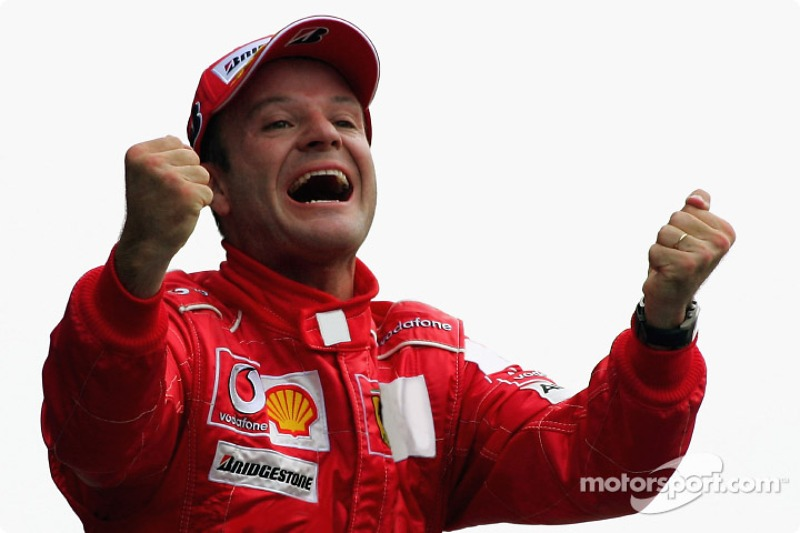 Race winner Rubens Barrichello celebrates
