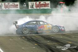 Race winner and DTM 2004 champion Mattias Ekström smokes the tires