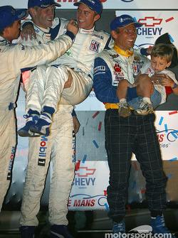 GT podium: David Murry and kid, Jorg Bergmeister and kid