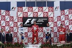 Podium: race winner Michael Schumacher with Ralf Schumacher and Jenson Button