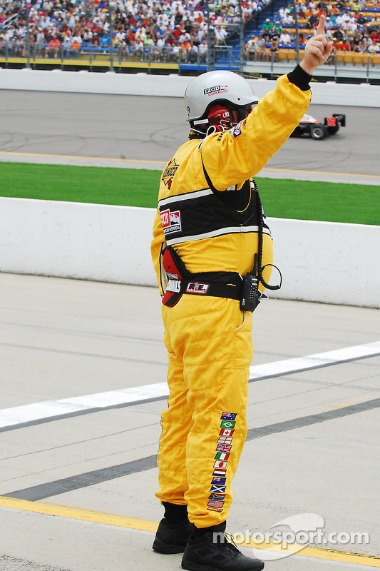 A pit road safety tech signals one to go