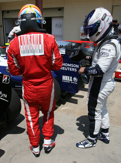 Fernando Alonso, Scuderia Ferrari and Rubens Barrichello, Williams F1 Team look at the Red Bull