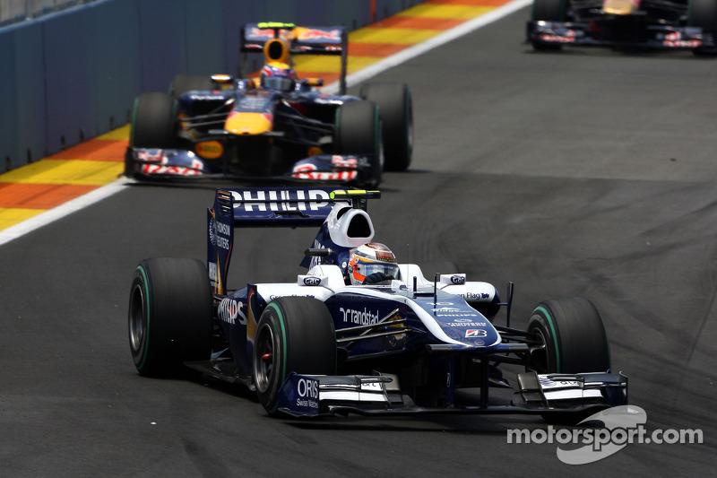 Nico Hulkenberg, Williams F1 Team leads Mark Webber, Red Bull Racing